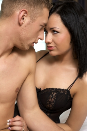 erotic couple: intimate young couple during foreplay Stock Photo