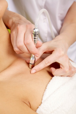 Young brunette woman receiving laser therapy  Spa studio shot photo