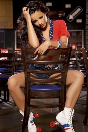 happy brunette teenager on rollerblading sitting on the restaurant Stock Photo - 21896251