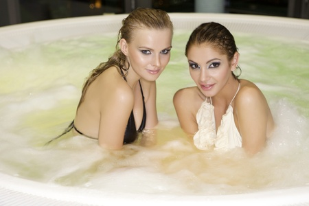 two young beautiful brunette girls in hot tab photo