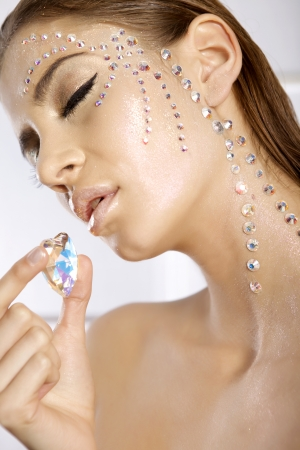 beautiful brunette lovely woman with diamond heart photo