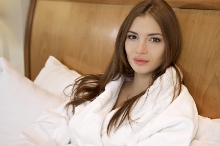 beautiful brunette woman in bed Stock Photo - 23528219