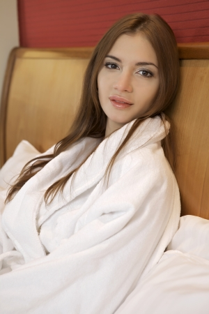 beautiful brunette woman in bed Stock Photo - 23528220