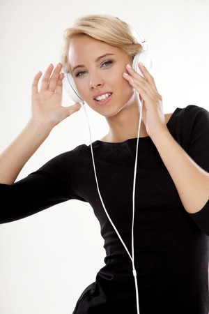 sensuality: Beautiful adult sensuality blonde girl is listen to the music