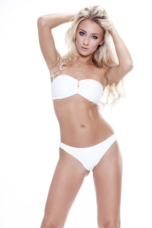 adult sexy: Sexy blonde woman wearing white swimwear isolated on white background. Perfect body