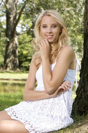 sensuality: beautiful blond sensuality woman in the garden
