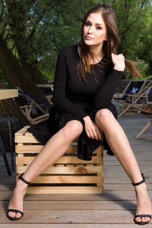 sensuality: Portrait of a attractibe sensuality and beautiful young adult brunette woman in the park