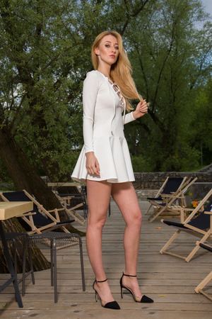sensuality: Portrait of a attractibe sensuality and beautiful young adult blonde woman in the park