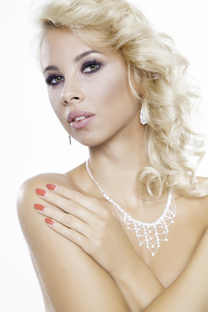 Close up portrait of beautiful blonde woman wearing jewelry isolated on white background photo