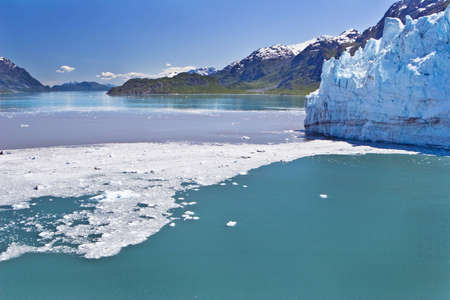 Ice and debris from a calving glacier dot Glacier Bay in Alaska Stock Photo - 2024924