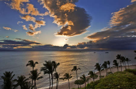 Sunset casts a golden glow over  Kaanapali Beach on Maui.