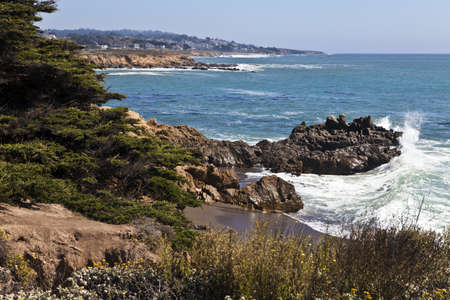 Surf crashes against the rugged shoreline at the north end of Moonstone Beach in Cambria, California. Stock Photo