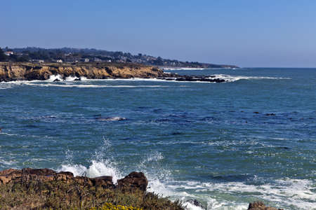 north   end: Surf crashes against the rugged shoreline at the north end of Moonstone Beach in Cambria, California. Stock Photo