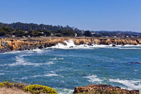 Waves pound the rugged shoreline along Moonstone Beach in Cambria, California.