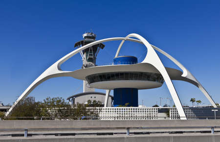 Restaurant and control tower rise between terminals at Los Angeles International Airport