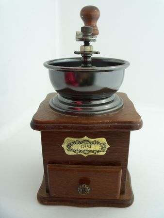 crank: A traditional hand crank coffee mill