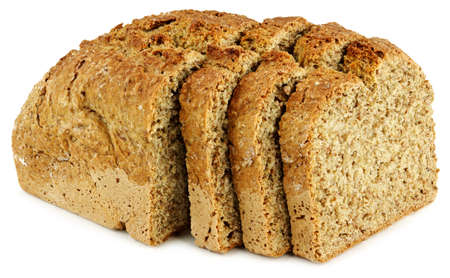 a loaf of bread with three slices on a white table Stock Photo