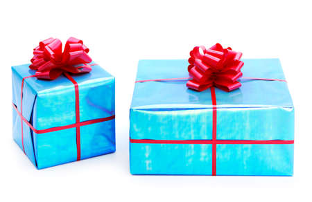 A turquoise blue presents tied with red bows on a white background Stock Photo