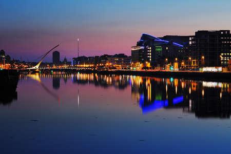 liffey: DUBLIN, IRELAND - JULY 22  Night skyline of the Dublin City Center on July 22, 2013 in Dublin, Ireland  Samuel Beckett Bridge on the river Liffey was designed by architect Santiago Calatrava