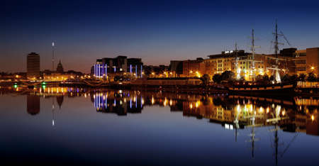 DUBLIN, IRELAND - JULY 22  Night skyline of the Dublin City Center reflecting in the river Liffey as seen from the south bank on July 22, 2013 in Dublin, Ireland