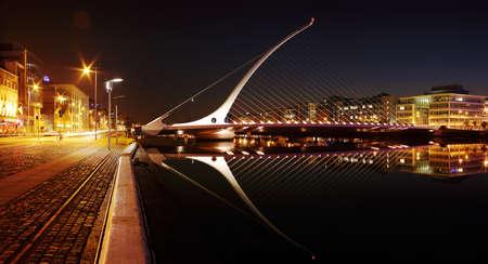DUBLIN, IRELAND - JULY 22  Samuel Beckett Bridge by architect Santiago Calatrava reflecting in the river Liffey on July 22, 2013 in Dublin, Ireland Editorial