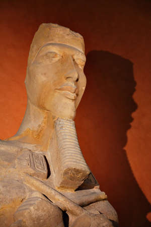 An old Egyptian sculpture showing a mask of a Pharaoh