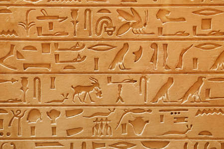 decipher: An old Egyptian pictorial writing on a sandstone