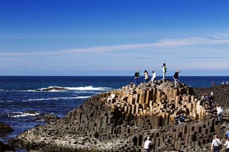 The famous Giant s Causeway of Northern Ireland is an area of about 40,000 interlocking basalt columns  This natural attraction is listed as one of World Heritage Unesco Sites  Stock Photo