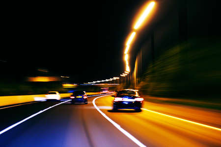 An impression style of picture of moving traffic on a motor way at night
