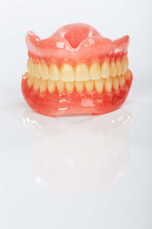 dental resin: A set of dentures on a shiny white background