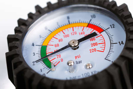 pressure gauge: A compressor pressure gauge on a white background Stock Photo