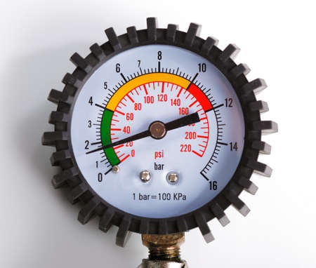 A compressor pressure gauge on a white background Stock Photo