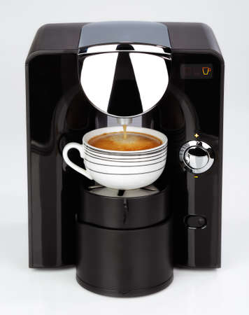 espresso machine: A black modern espresso coffee machine is making a coffee on a white background