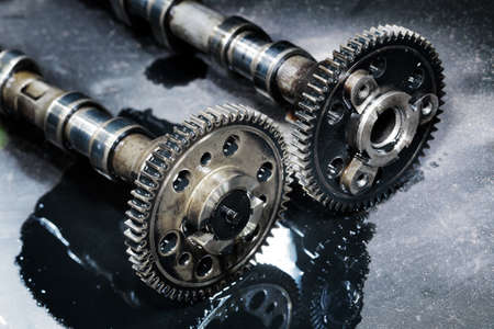 cam gear: cam shaft of a turbo diesel engine on a dark background Stock Photo