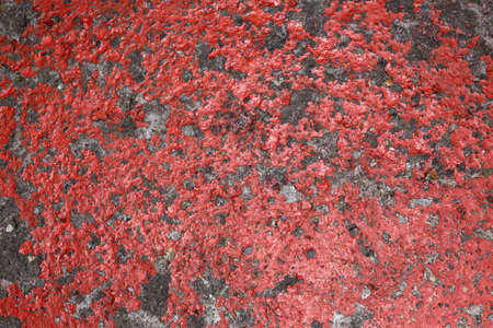 An abstract pattern of an old red painted concrete floor Stock Photo