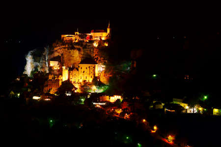 classed: The Rocamadour village in France with famous monastery at night  Rocamadour is classed as a World Heritage Site by UNESCO