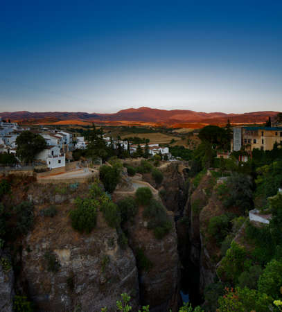 Magnificent view from the New Bridge of Ronda in Andalusia, Spain at evening photo