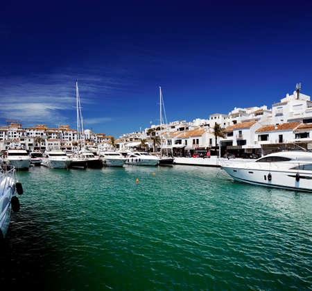 Luxury yachts and motor boats moored in Puerto Banus marina in Marbella, Spain