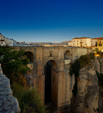 The New Bridge in the village of Ronda in Andalusia, Spain at evening  This 120 meters tall bridge was built in 1751 photo