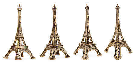 Close up view of a small Eiffel tower statue photographed with different perspectives on white background photo