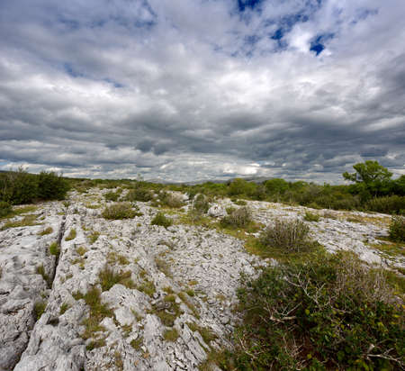Rocky landscape of the Limestone Pavement Mountains in The Burren in County Clare, Ireland photo
