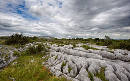 rock strata: Rocky landscape of the Limestone Pavement Mountains in The Burren in County Clare, Ireland Stock Photo