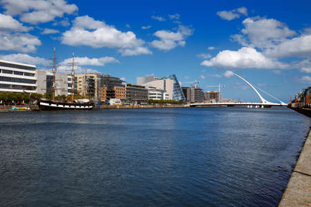 liffey: North bank of the river Liffey at Dublin City Centre with Samuel Beckett Bridge