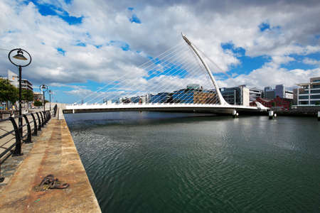 liffey: Samuel Beckett Bridge by architect Santiago Calatrava and both banks of the river Liffey in Dublin City Centre Editorial