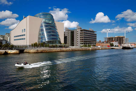 eventide: North bank of the river Liffey at Dublin City Center with Dublin Convention Center CCD as seen from the Samuel Beckett Bridge Editorial