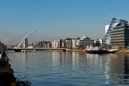 liffey: The Samuel Beckett Bridge, Dublin Convention Center and the north banks of the river Liffey in Dublin City Centre Stock Photo
