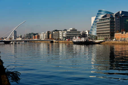 liffey: The Samuel Beckett Bridge, Dublin Convention Center and the north banks of the river Liffey in Dublin City Centre Editorial