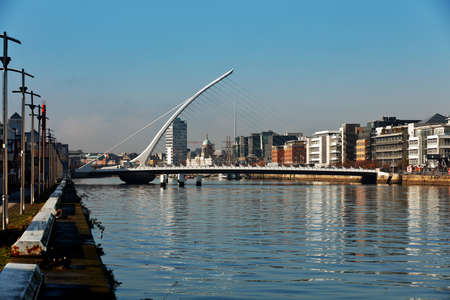 liffey: Samuel Beckett Bridge by architect Santiago Calatrava and both banks of the river Liffey in Dublin City Centre Stock Photo