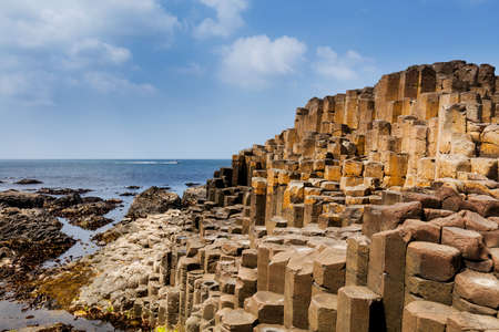 The Giants Causeway in County Antrim of Northern Ireland is declared a World Heritage Site by UNESCO containing about 40000 interlocking basalt columns being a result of an ancient volcanic eruption Stock Photo