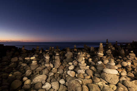 The Stone Towers on Tenerife Punta Brava beach. These stacked piles of rock serve as temples of peace and Zen on Canary Islands Stock Photo